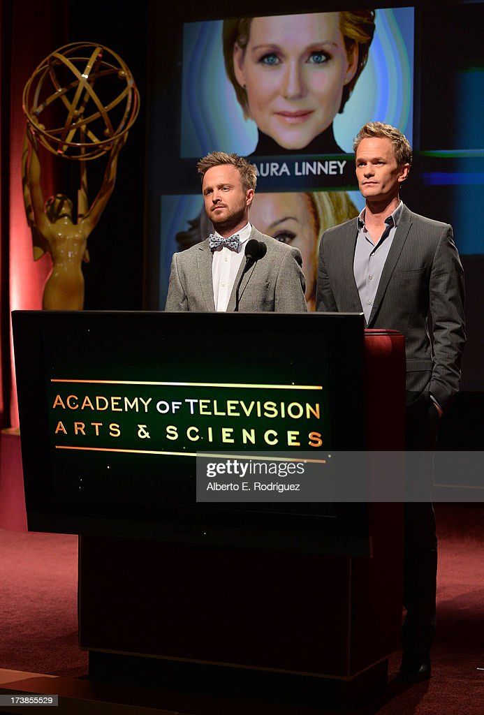 Actors Aaron Paul (L) and Neil Patrick Harris announce the nominees for the Outstanding Lead Actress in a Miniseries or Movie Award during the 65th Primetime Emmy Awards nominations at the Television Academy's Leonard H. Goldenson Theatre on July 18, 2013 in North Hollywood, California.