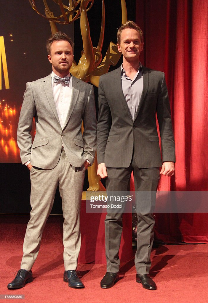 Actors <a gi-track='captionPersonalityLinkClicked' href=/galleries/search?phrase=Aaron+Paul+-+Actor&family=editorial&specificpeople=693211 ng-click='$event.stopPropagation()'>Aaron Paul</a> (L) and <a gi-track='captionPersonalityLinkClicked' href=/galleries/search?phrase=Neil+Patrick+Harris&family=editorial&specificpeople=210509 ng-click='$event.stopPropagation()'>Neil Patrick Harris</a> pose onstage during the 65th Primetime Emmy Awards nominations at the Television Academy's Leonard H. Goldenson Theatre on July 18, 2013 in North Hollywood, California.