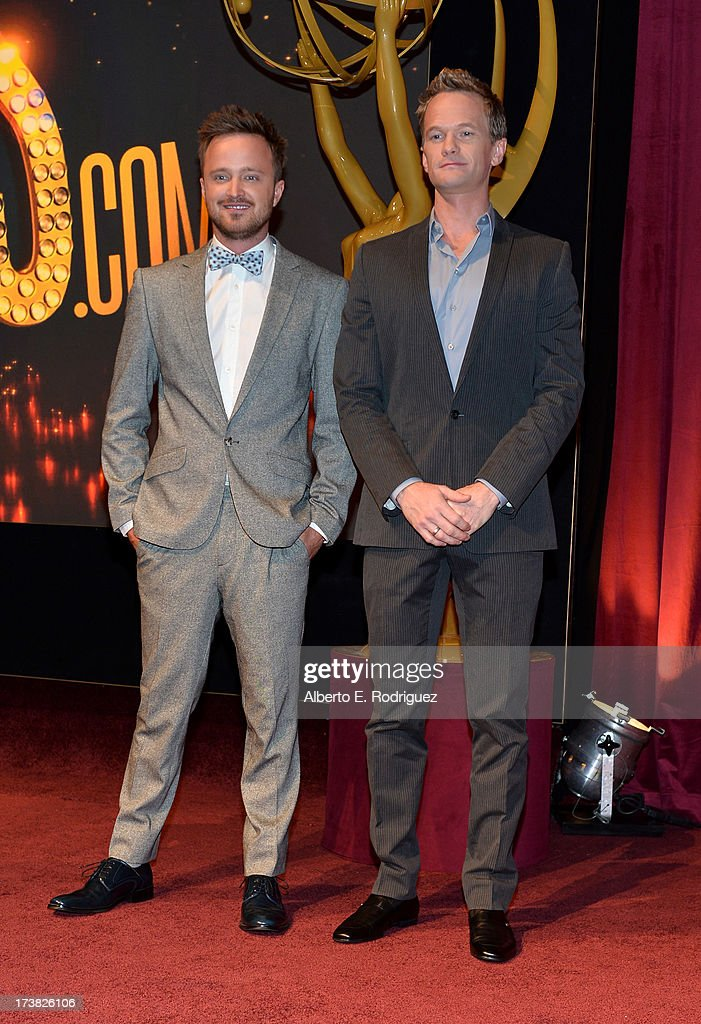 Actors <a gi-track='captionPersonalityLinkClicked' href=/galleries/search?phrase=Aaron+Paul+-+Actor&family=editorial&specificpeople=693211 ng-click='$event.stopPropagation()'>Aaron Paul</a> (L) and <a gi-track='captionPersonalityLinkClicked' href=/galleries/search?phrase=Neil+Patrick+Harris&family=editorial&specificpeople=210509 ng-click='$event.stopPropagation()'>Neil Patrick Harris</a> pose onstage following the announcement of the nominees for the 65th Primetime Emmy Awards nominations at the Television Academy's Leonard H. Goldenson Theatre on July 18, 2013 in North Hollywood, California.