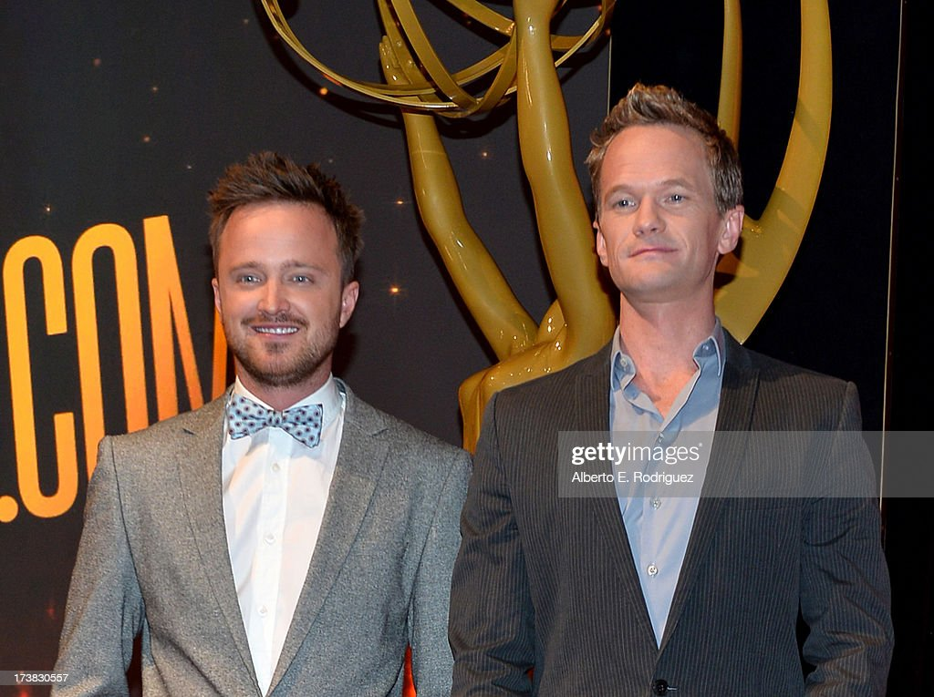 Actors Aaron Paul (L) and Neil Patrick Harris pose onstage following the 65th Primetime Emmy Awards nomination announcements at the Television Academy's Leonard H. Goldenson Theatre on July 18, 2013 in North Hollywood, California.