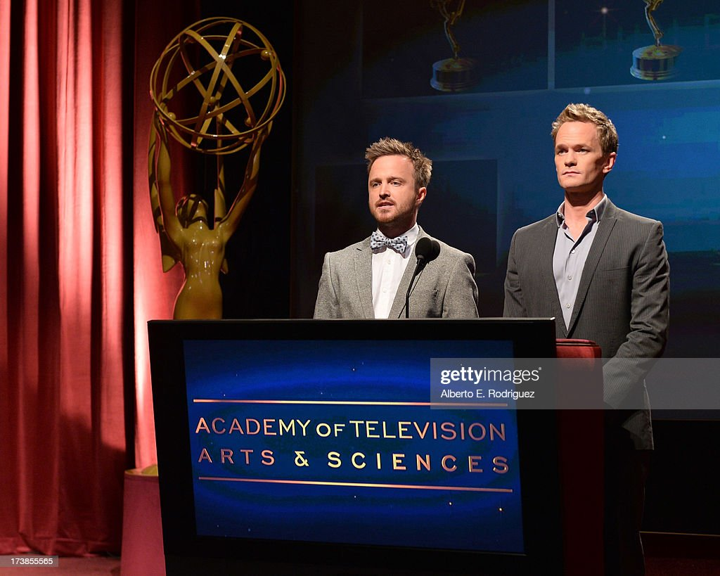 Actors Aaron Paul (L) and Neil Patrick Harris speak onstage at the 65th Primetime Emmy Awards nominations at the Television Academy's Leonard H. Goldenson Theatre on July 18, 2013 in North Hollywood, California.