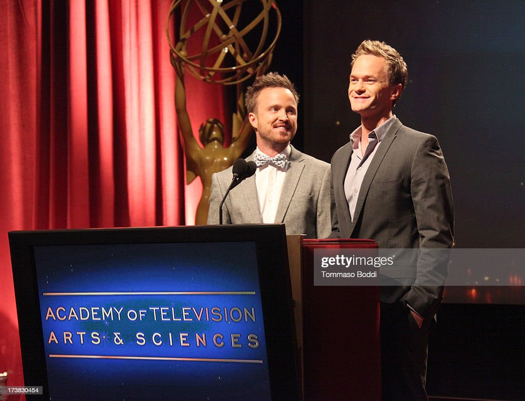 Actors <a gi-track='captionPersonalityLinkClicked' href=/galleries/search?phrase=Aaron+Paul+-+Actor&family=editorial&specificpeople=693211 ng-click='$event.stopPropagation()'>Aaron Paul</a> (L) and <a gi-track='captionPersonalityLinkClicked' href=/galleries/search?phrase=Neil+Patrick+Harris&family=editorial&specificpeople=210509 ng-click='$event.stopPropagation()'>Neil Patrick Harris</a> speak onstage during the 65th Primetime Emmy Awards nominations at the Television Academy's Leonard H. Goldenson Theatre on July 18, 2013 in North Hollywood, California.