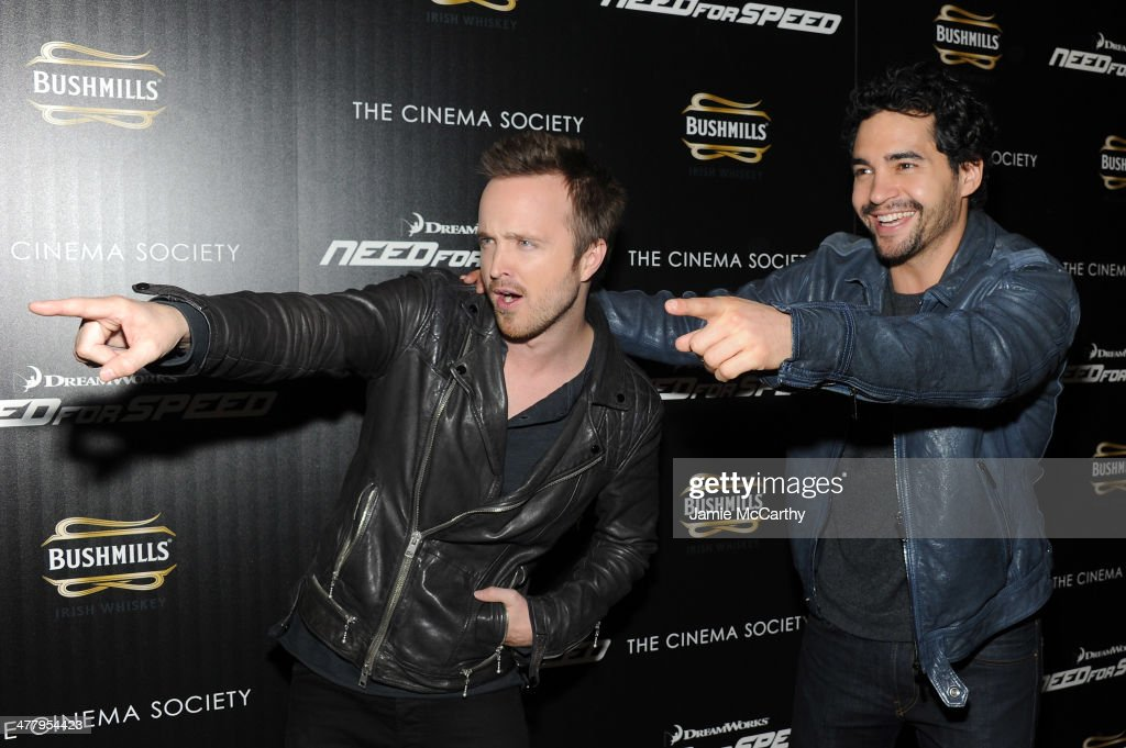 Actors <a gi-track='captionPersonalityLinkClicked' href=/galleries/search?phrase=Aaron+Paul+-+Actor&family=editorial&specificpeople=693211 ng-click='$event.stopPropagation()'>Aaron Paul</a> (L) and <a gi-track='captionPersonalityLinkClicked' href=/galleries/search?phrase=Ramon+Rodriguez&family=editorial&specificpeople=73608 ng-click='$event.stopPropagation()'>Ramon Rodriguez</a> attend DreamWorks Pictures' 'Need For Speed' screening hosted by The Cinema Society and Bushmills on March 11, 2014 in New York City.