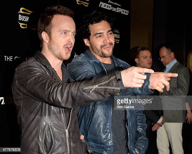 Actors Aaron Paul and Ramon Rodriguez attend The Cinema Society Bushmill's screening of DreamWorks Pictures' 'Need for Speed' at the Tribeca Grand...