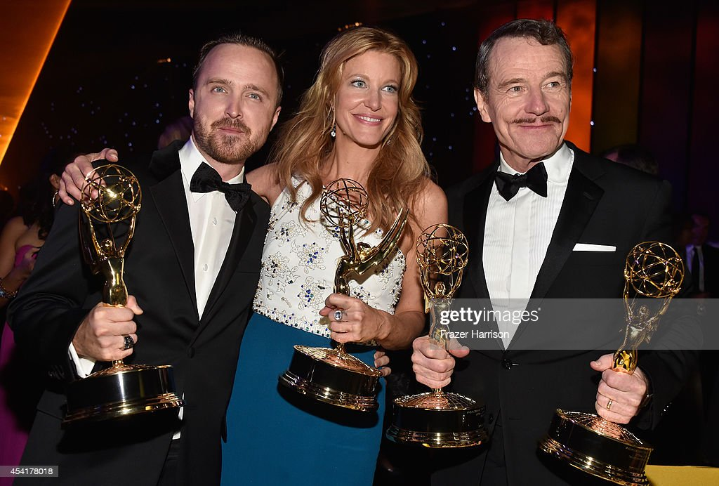 Actors Aaron Paul, Anna Gunn and Bryan Cranston attend the 66th Annual Primetime Emmy Awards Governors Ball held at Los Angeles Convention Center on August 25, 2014 in Los Angeles, California.