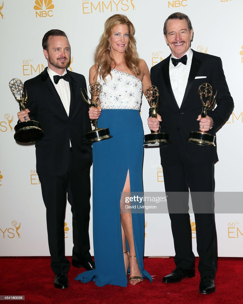 Actors Aaron Paul, Anna Gunn and Byran Cranston pose in the press room at the 66th Annual Primetime Emmy Awards at the Nokia Theatre L.A. Live on August 25, 2014 in Los Angeles, California.