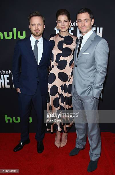 Actors Aaron Paul Michelle Monaghan and Hugh Dancy arrive during the premiere of Hulu's 'The Path' at ArcLight Hollywood on March 21 2016 in...