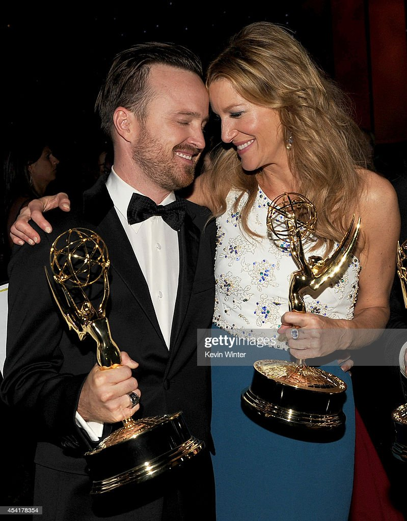 Actors Aaron Paul (L), winner of the award for Outstanding Supporting Actor in a Drama Series, and Anna Gunn, winner of the award for Outstanding Supporting Actress in a Drama Series, for the show 'Breaking Bad', attend the 66th Annual Primetime Emmy Awards Governors Ball held at Los Angeles Convention Center on August 25, 2014 in Los Angeles, California.