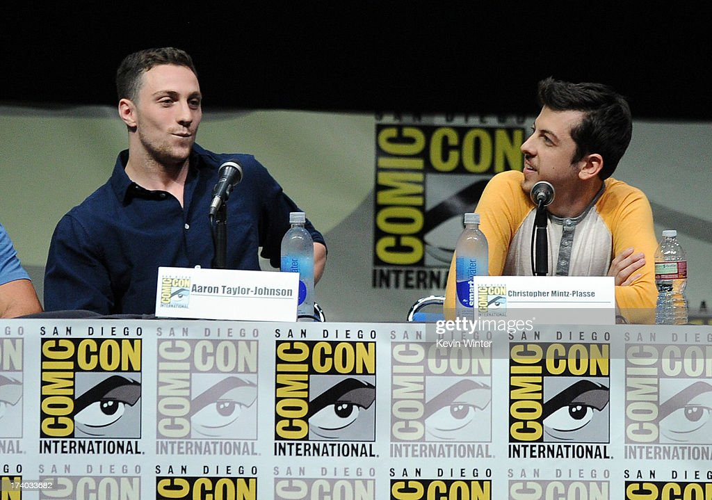 Actors Aaron Taylor-Johnson (L) and Christopher Mintz-Plasse speak onstage at the 'Kick-Ass 2' and 'Riddick' Panels during Comic-Con International 2013 at San Diego Convention Center on July 19, 2013 in San Diego, California.