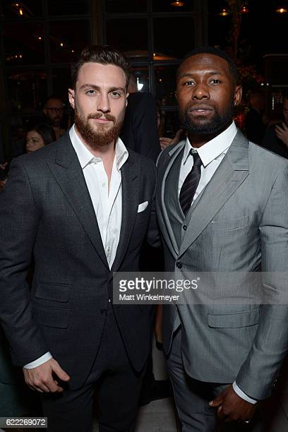 Actors Aaron TaylorJohnson and Trevante Rhodes attend the Hollywood Foreign Press Association and InStyle celebrate the 2017 Golden Globe Award...