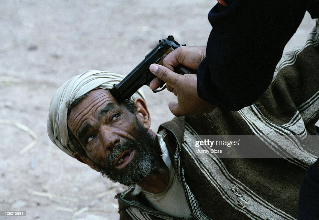 Actors Abdelkader Bara as Hassan is questioned by the police in a scene from the movie 'Babel', being filmed on location in Morocco, 2005. The film was directed by Alejandro Gonzalez Inarritu.