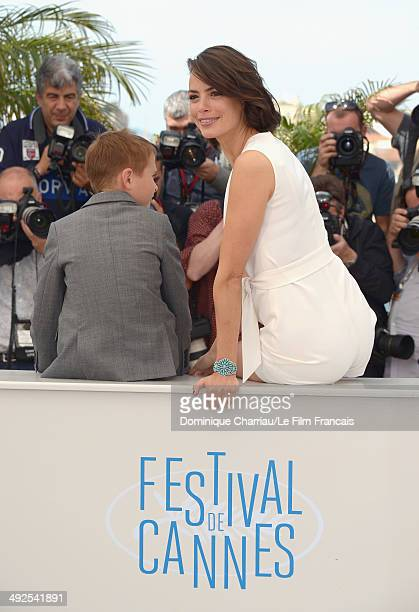 Actors Abdul Khalim Mamatsuiev and Berenice Bejo attend 'The Search' photocall at the 67th Annual Cannes Film Festival on May 21 2014 in Cannes France