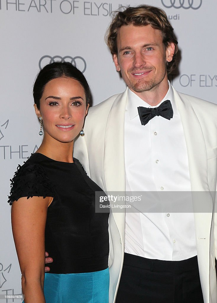 Actors Abigail Spencer (L) and Josh Pence attend the Art of Elysium's 6th Annual Black-tie Gala 'Heaven' at 2nd Street Tunnel on January 12, 2013 in Los Angeles, California.