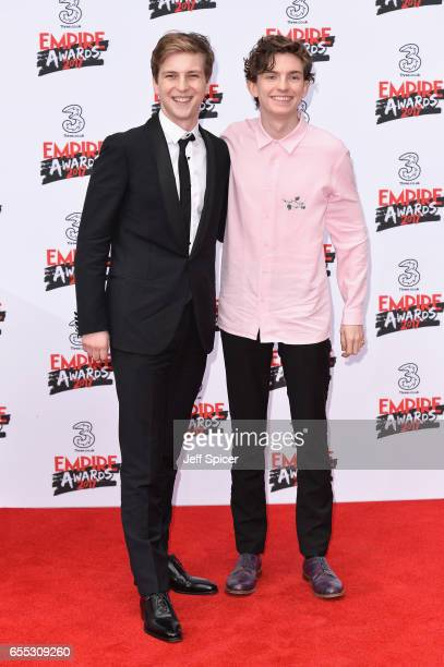 Actors Abraham Lewis and Bill Milner attend the THREE Empire awards at The Roundhouse on March 19 2017 in London England