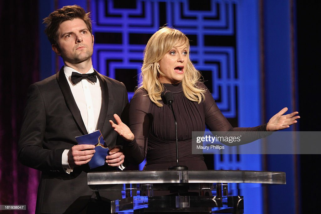 Actors Adam Scott and Amy Poehler speak onstage at the 2013 WGAw Writers Guild Awards at JW Marriott Los Angeles at L.A. LIVE on February 17, 2013 in Los Angeles, California.