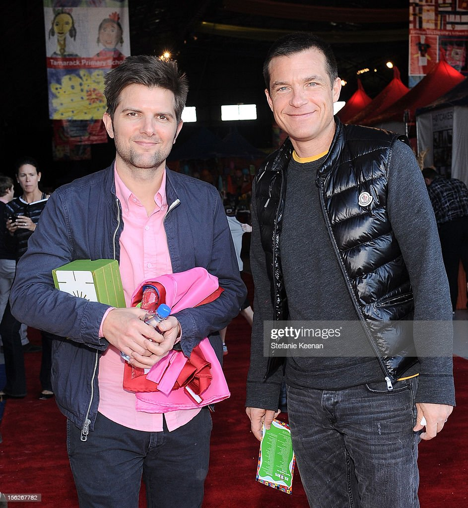 Actors Adam Scott (L) and <a gi-track='captionPersonalityLinkClicked' href=/galleries/search?phrase=Jason+Bateman&family=editorial&specificpeople=204774 ng-click='$event.stopPropagation()'>Jason Bateman</a> attend the creative arts fair and family day 'Express Yourself', supporting P.S. ARTS, at Barker Hangar on November 11, 2012 in Santa Monica, California.