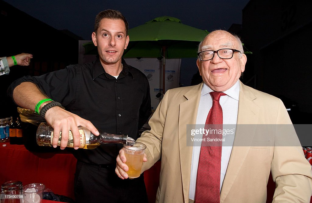 Actors Adam Solon and <a gi-track='captionPersonalityLinkClicked' href=/galleries/search?phrase=Ed+Asner&family=editorial&specificpeople=216485 ng-click='$event.stopPropagation()'>Ed Asner</a> attend the Concern Foundation block party at Paramount Studios on July 13, 2013 in Hollywood, California.