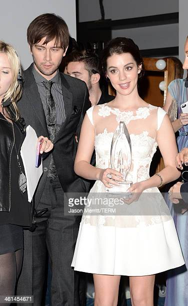 Actors Adelaide Kane and Torrance Coombs winners of the Favorite New TV Drama award for 'Reign' pose in the press room at The 40th Annual People's...