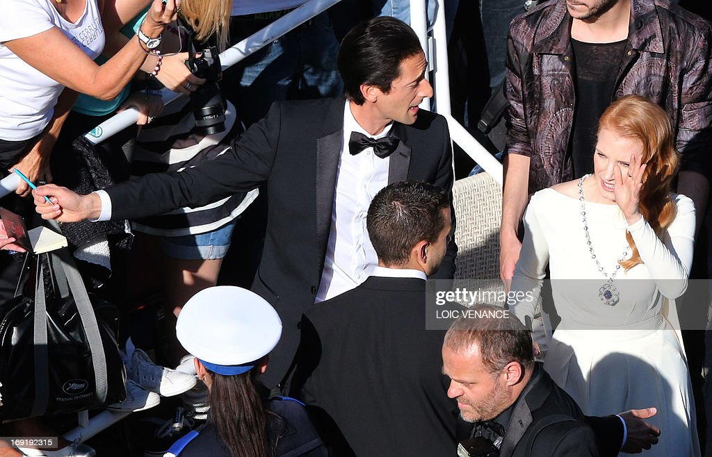 US actors Adrien Brody (L) and Jessica Chastain sign autographs on May 21, 2013 as they arrive for the screening of the film 'Cleopatra' presented in Cannes Classics at the 66th edition of the Cannes Film Festival in Cannes. Cannes, one of the world's top film festivals, opened on May 15 and will climax on May 26 with awards selected by a jury headed this year by Hollywood legend Steven Spielberg.
