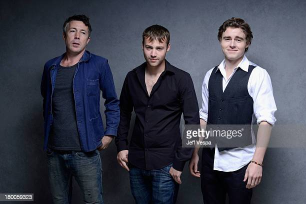 Actors Aidan Gillen Emory Cohen and Callan McAuliffe of 'Beneath The Harvest Sky' pose at the Guess Portrait Studio during 2013 Toronto International...