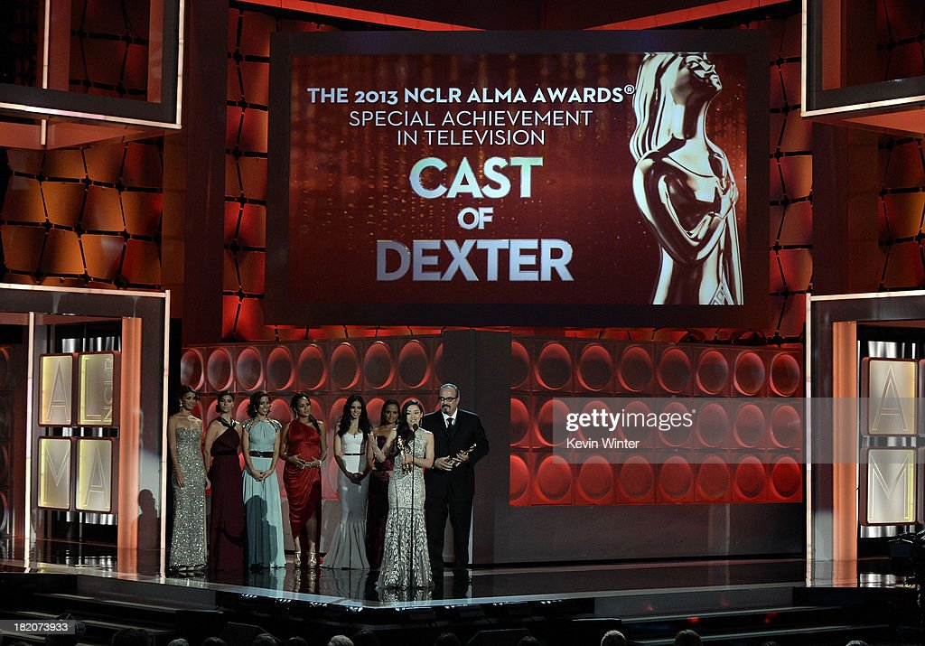 Actors Aimee Garcia and David Zayas accept the Special Achievement in Television award for 'Dexter' onstage during the 2013 NCLR ALMA Awards at...