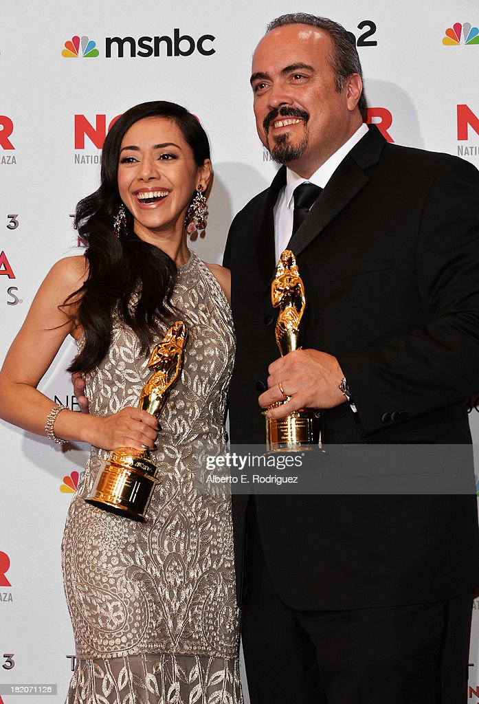 Actors Aimee Garcia and David Zayas pose with the Special Achievement in Television awards for 'Dexter' at the Winner's Walk during the 2013 NCLR...