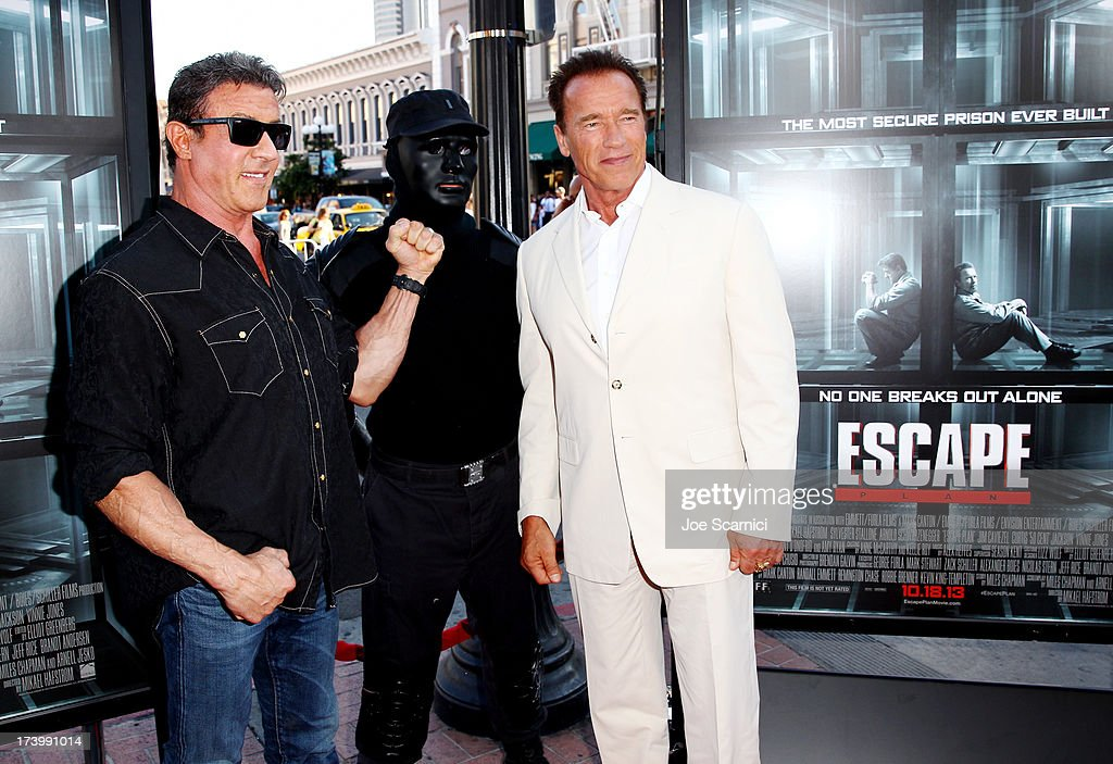 Actors Al Pacino (L) and Arnold Schwarzenegger attend the 'Escape Plan' screening and red carpet during Comic-Con International 2013 at Reading Cinemas Gaslamp on July 18, 2013 in San Diego, California.