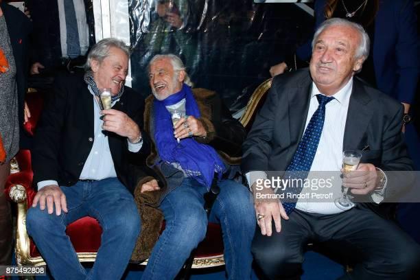 Actors Alain Delon and JeanPaul Belmondo come to see their friend Marcel Campion for 'La Grande Roue de Paris' Opening Ceremony at Place de la...