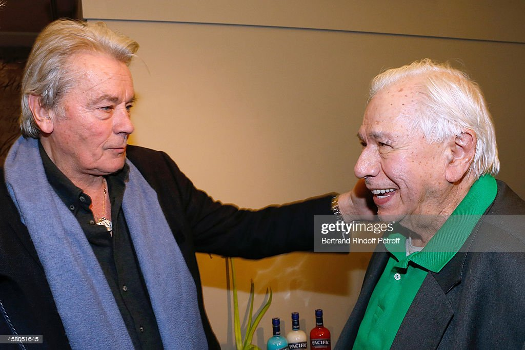 Actors Alain Delon and Michel Galabru pose backstage following the show of impersonator Laurent Gerra 'Un spectacle Normal' at L'Olympia on December 19, 2013 in Paris, France.