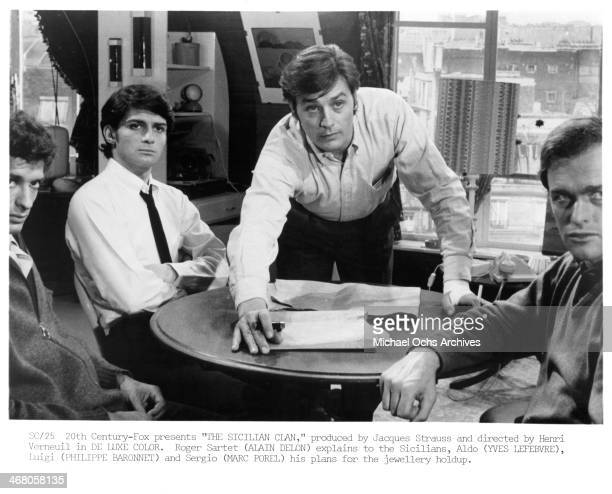 Actors Alain Delon and Yves Brainville and Philippe Baronnet on set of the movie 'The Sicilian Clan ' circa 1969