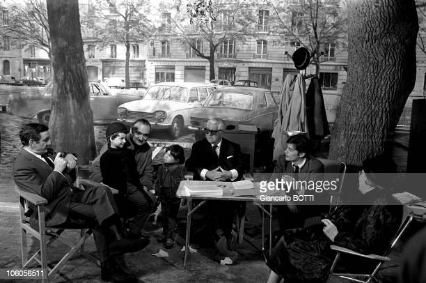 Actors Alain Delon Lino Ventura Jean Gabin and director Henri Verneuil on the set of the movie The Sicilian Clan directed by Henri Verneuil in 1969...
