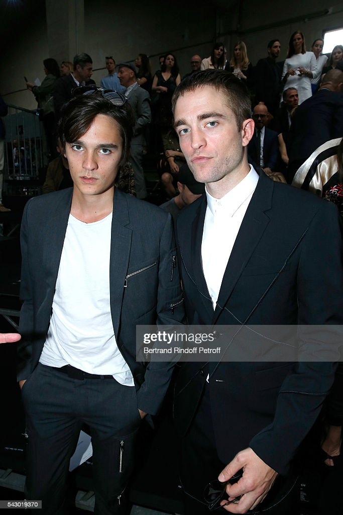 Actors Alain-Fabien Delon and Robert Pattinson attend the Dior Homme Menswear Spring/Summer 2017 show as part of Paris Fashion Week on June 25, 2016 in Paris, France.