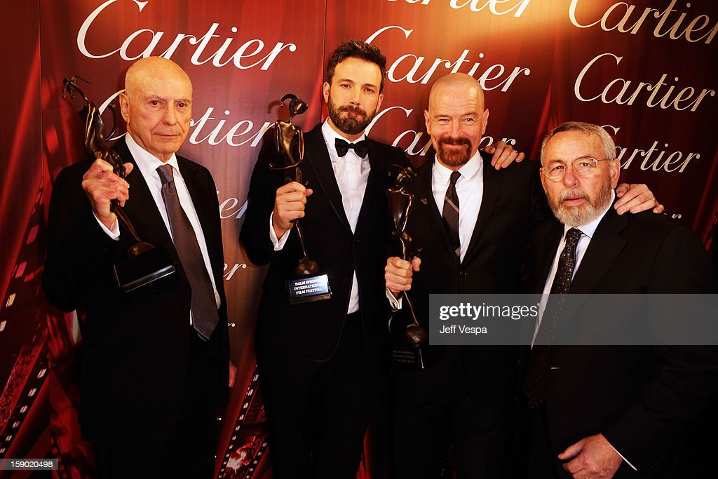 Actors Alan Arkin, Ben Affleck, Bryan Cranston and former American CIA Technical Operations Officer Tony Mendez pose with the Ensemeble Performance Award during the 24th annual Palm Springs International Film Festival Awards Gala at the Palm Springs Convention Center on January 5, 2013 in Palm Springs, California.