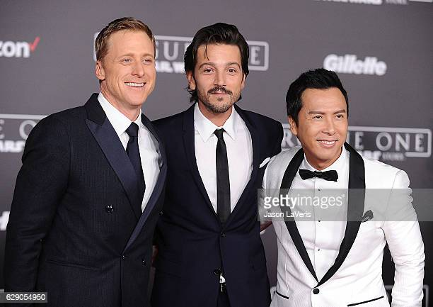 Actors Alan Tudyk Diego Luna and Donnie Yen attend the premiere of 'Rogue One A Star Wars Story' at the Pantages Theatre on December 10 2016 in...