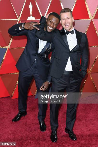 Actors Aldis Hodge and Glen Powell attend the 89th Annual Academy Awards at Hollywood Highland Center on February 26 2017 in Hollywood California