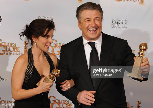 Actors Alec Baldwin and Tiny Fey pose with her awards for Best Performance by an Actor and an Actress In a Television Series Musical or Comedy for...