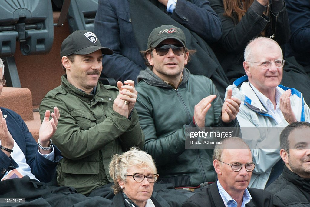 Actors Alessandro Nivola and Bradley Cooper attend the French open at Roland Garros on May 31, 2015 in Paris, France.