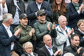 Actors Alessandro Nivola and Bradley Cooper attend the French open at Roland Garros on May 31 2015 in Paris France