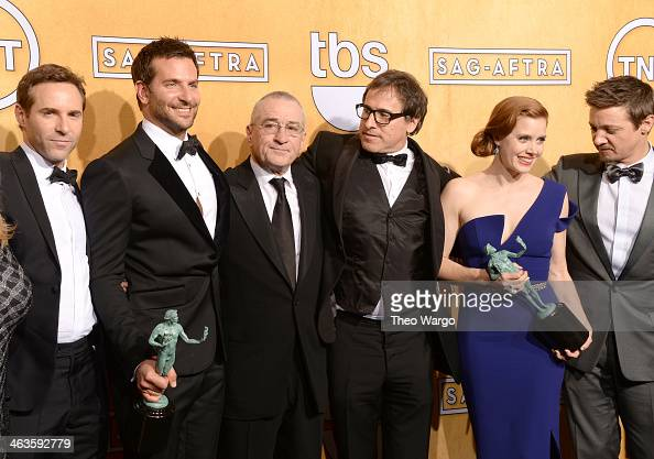 Actors Alessandro Nivola Bradley Cooper Robert De Niro director David O Russell and actors Amy Adams and Jeremy Renner pose for a portrait during...
