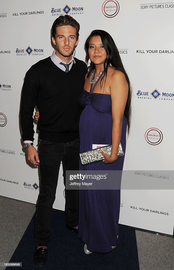 Actors Alex Hafner (L) and Misty Upham arrive at the Los Angeles premiere of 'Kill Your Darlings' at the Writers Guild Theater on October 3, 2013 in Beverly Hills, California.