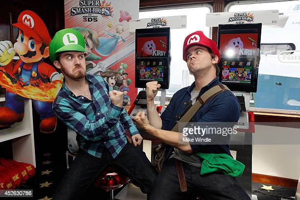 Actors Alex Hirsch and Jason Ritter attend the Nintendo Lounge on the TV Guide Magazine Yacht during ComicCon International 2014 #TVGMYacht on July...
