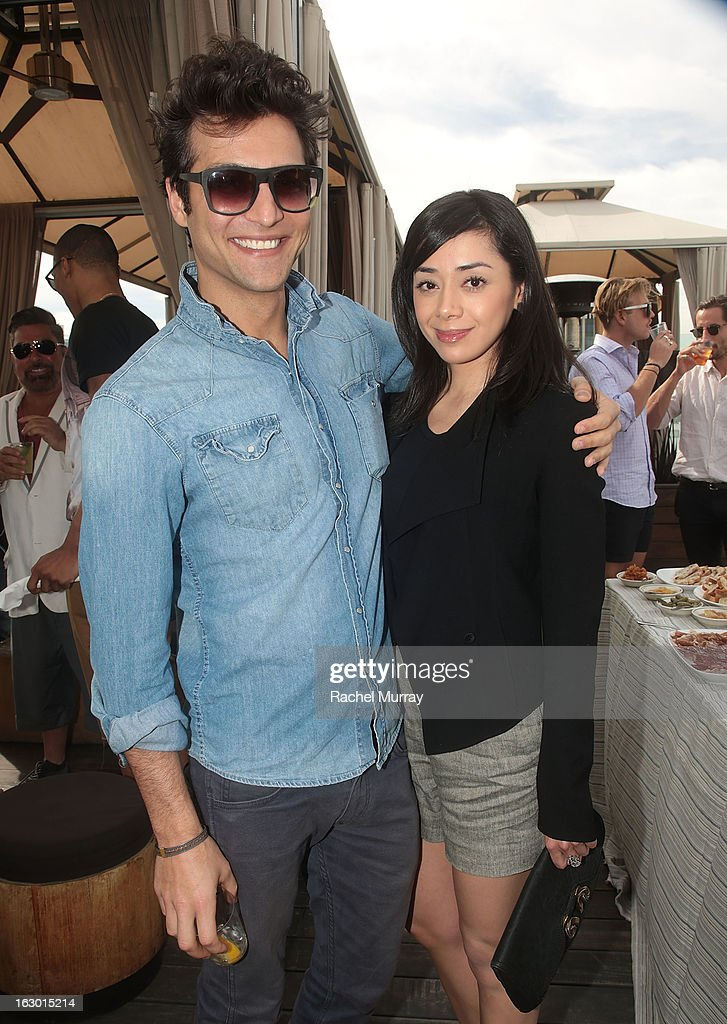 Actors Alexander DiPersia (L) and Aimee Garcia attend Flaunt Magazine and Samsung Galaxy celebrate The Plutocracy Issue release hosted by cover Russell Westbrook at Caulfield's Bar and Dining Room at Thompson Hotel on March 2, 2013 in Beverly Hills, California.
