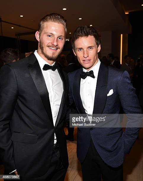 Actors Alexander Ludwig and Eddie Redmayne attend amfAR LA Inspiration Gala honoring Tom Ford at Milk Studios on October 29 2014 in Hollywood...