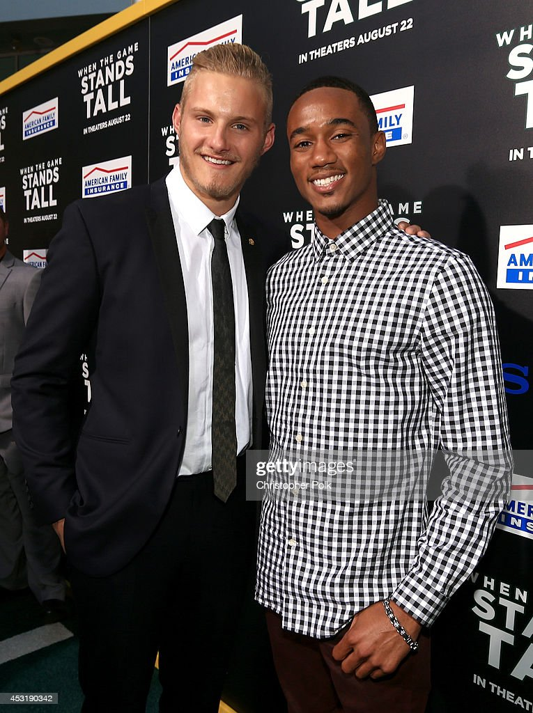Actors Alexander Ludwig (L) and Jessie Usher attend the premiere of Tri Star Pictures' 'When The Game Stands Tall' at ArcLight Cinemas on August 4, 2014 in Hollywood, California.