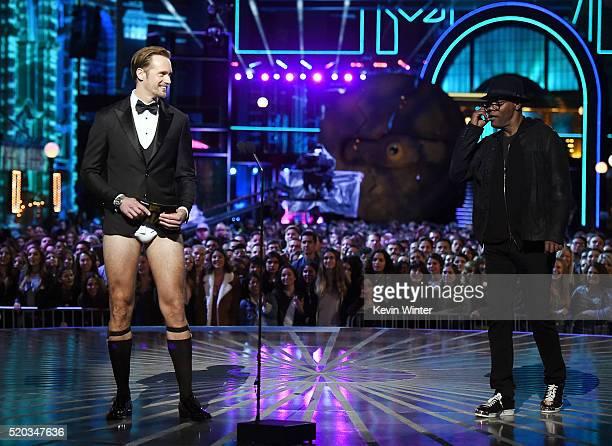 Actors Alexander Skarsgard and Samuel L Jackson speak onstage during the 2016 MTV Movie Awards at Warner Bros Studios on April 9 2016 in Burbank...