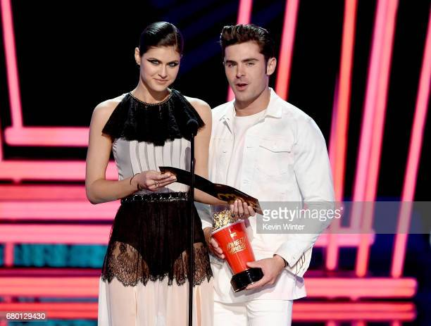 Actors Alexandra Daddario and Zac Efron speak onstage during the 2017 MTV Movie And TV Awards at The Shrine Auditorium on May 7 2017 in Los Angeles...