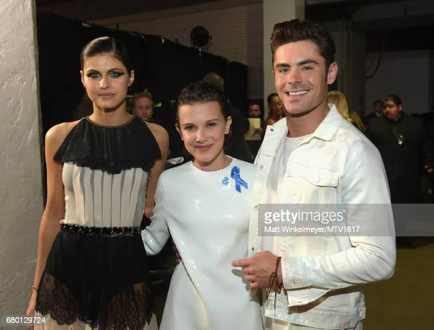 Actors Alexandra Daddario Millie Bobby Brown and Zac Efron attend the 2017 MTV Movie And TV Awards at The Shrine Auditorium on May 7 2017 in Los...