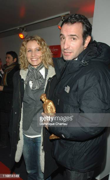 Actors Alexendra Lamy and Jean Dujardin attend the 2nd Edition of 'Raimu De La Comedie' on December 17 2007 in Paris France