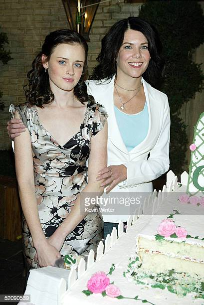 Actors Alexis Bledel and Lauren Graham pose at The WB Networks 'The Gilmore Girls' 100th episode celebration on the set at Warner Bros Studios on...
