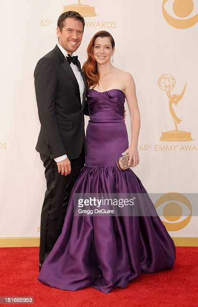 Actors Alexis Denisof and Alyson Hannigan arrive at the 65th Annual Primetime Emmy Awards at Nokia Theatre LA Live on September 22 2013 in Los...